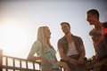 Hanging out group of three young adults laughing and having a good time Royalty Free Stock Photo