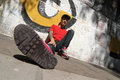 Hanging out a rapper leaning against a graffiti wall Royalty Free Stock Photography