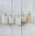 Hanging photos old on the rope with clothespin against white planks Royalty Free Stock Image