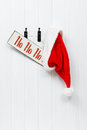 Hanging Santa Hat & Sign Royalty Free Stock Photography