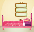 Hanging signboards inside a room with a pink bed illustration of the Stock Photo
