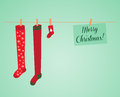 Hanging socks vector christmas card with Royalty Free Stock Photography