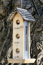 Hanging tall bird house birdhouse outdoor old handmade nice sunny day Royalty Free Stock Image