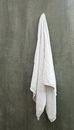 Hanging White Towel draped on Exposive Concrete Wall Royalty Free Stock Photo