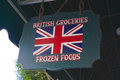 Hanging wooden sign advertises british groceries frozen foods Royalty Free Stock Photography