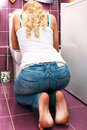 Hangover after party woman in the toilet Stock Images