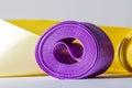 Hank silk purple ribbon, close-up, macro on a grey
