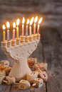 Hannukah background jewish holiday symbols menorah and wooden dreidels copy space Stock Image