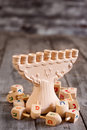 Hannukah background jewish holiday symbols menorah and wooden dreidels copy space Royalty Free Stock Photos