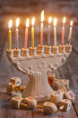 Hannukah jewish holiday symbols menorah and wooden dreidels Stock Photo