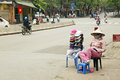 HANOI, VIETNAM - MAY 2014: street seller woman Royalty Free Stock Photo
