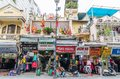 Various type of historic retail shops building in Hanoi, Vietnam. People can seen having their food beside the street. Royalty Free Stock Photo