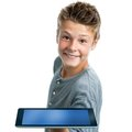 Hansome teen showing blank tablet close up portrait of cute boy isolated on white background Royalty Free Stock Photo