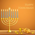 Hanukkah background illustration of burning candle in menorah with dreidel Stock Images