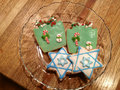 Hanukkah chanukah christmas xmas cookie plate of two cookies and two x mas cookies Stock Photo