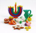 Hanukkah handmade plasticine toys. Modeling clay colorful texture.  on white background Royalty Free Stock Photo