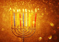 Hanukkah menorah with burning candles colorful Stock Photos