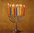 Hanukkah menorah with burning candles colorful Royalty Free Stock Photo