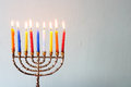 Hanukkah menorah with burning candles colorful Royalty Free Stock Images