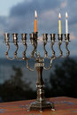 Hanukkah menorah on the second day of hanukkah with three burning candles Stock Images