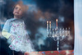 Hanukkah menorah on the second day of hanukkah with three burning candles Stock Image