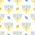 Hanukkah seamless pattern background with menorah and dreidel.