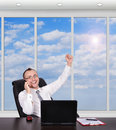 Hapiness manager customer service representative sitting in office with laptop Royalty Free Stock Photo