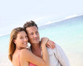 Happily married couple on the beach in tropics portrait of loving middle aged at Royalty Free Stock Photo
