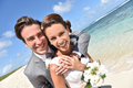 Happily married newly weds on the beach smiling portrait of happy just couple at Stock Photo