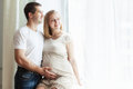 Happiness couple is posing woman is pregnant Stock Photo