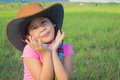 A happiness cowgirl on a field under sunshine Stock Photos
