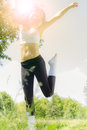 Happiness girl jumping on the green fields at beautiful summer day Stock Photo