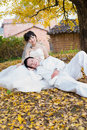 Happiness groom and bride in ginkgo forest just married Royalty Free Stock Photos