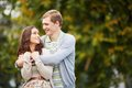 Happiness happy girl and her boyfriend having walk in park Royalty Free Stock Photos