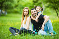 Happiness and harmony in family life. Happy family concept. Young mother and father with their daughter in the park. Happy family Royalty Free Stock Photo