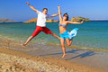 Happiness jump on the beach Royalty Free Stock Photos