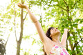 Happiness and relax on nature happy carefree woman raising arms to the sky fresh bright spring greenery caucasian beautiful girl Stock Images