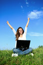 Happiness woman with laptop young sitting on grass Royalty Free Stock Photos