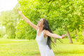 Happiness young woman enjoyment in the nature with sprading hands and beautiful day Stock Image