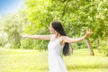 Happiness young woman enjoyment in the nature with sprading hands and beautiful day Royalty Free Stock Images