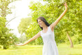 Happiness young woman enjoyment in the nature with sprading hands and beautiful day Stock Photo