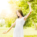 Happiness young woman enjoyment in the nature with sprading hands and beautiful day Royalty Free Stock Photo
