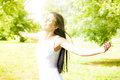 Happiness young woman enjoyment in the nature with sprading hands and beautiful day Royalty Free Stock Photos