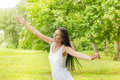 Happiness young woman enjoyment in the nature with sprading hands and beautiful day Stock Photography