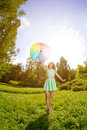 image photo : Happiness young woman with rainbow umbrella