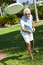 Happy Active Senior Man Throwing Frisbee Outside Royalty Free Stock Images