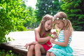 Happy adorable little girls enjoying warm summer Royalty Free Stock Photo