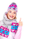 Happy adult girl in winter clothes with thumbs up photo of a bright positive emotions shows sign isolated on white Stock Photos
