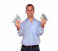 Happy adult man holding cash money portrait of a looking at you and against white background Royalty Free Stock Photos