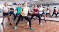 Happy adults having group fitness class Royalty Free Stock Photo